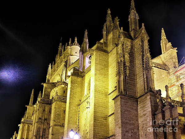 Catedral De Sevilla Wall Art - Photograph - Seville Cathedral Dimensions At Night In Spain by John Rizzuto