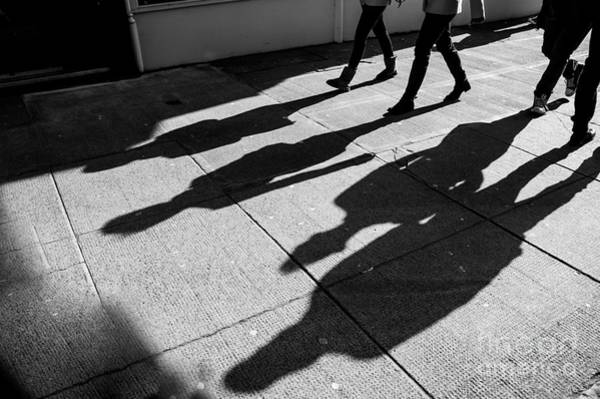 Wall Art - Photograph - Shadows Of Four Walking Pedestrians by Drimafilm