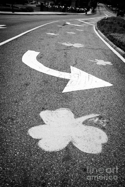 Wall Art - Photograph - shamrocks painted in the road in Dublin Georgia USA by Joe Fox