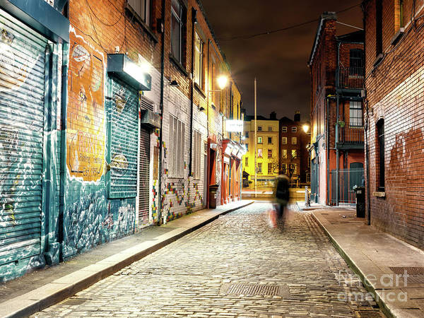 Wall Art - Photograph - She Walks At Night In Dublin by John Rizzuto