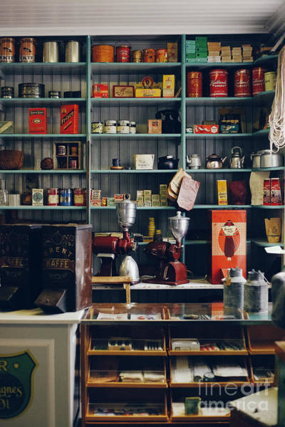 Photograph - Shelves With Products In Old Store by Joaquin Corbalan