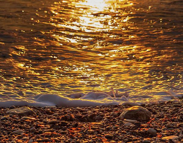Stone Wall Art - Photograph - Shining Sunset Pebbles 2 by Iordanis Pallikaras