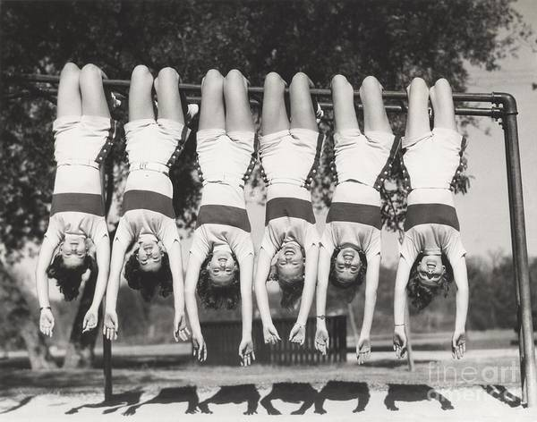 Wall Art - Photograph - Showgirls Hanging From Monkey Bars by Everett Collection