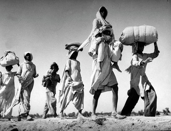 Hindu Photograph - Sikh Carrying His Wife On His Shoulders by Margaret Bourke-white