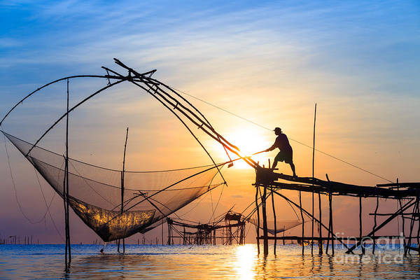 Wall Art - Photograph - Silhouette Fishermen Are Using Nets Get by Avigator Fortuner