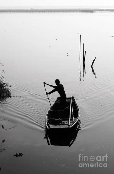 Remote Photograph - Silhouette Of A Boatman Rowing A by Gwoeii