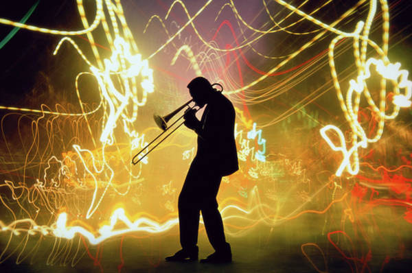 Wall Art - Photograph - Silhouette Of A Trombone Player & Light by Mitchell Funk