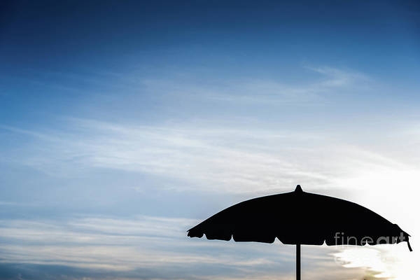 Photograph - Silhouette Of Beach Umbrella Against Backlight On A Hot Summer D by Joaquin Corbalan