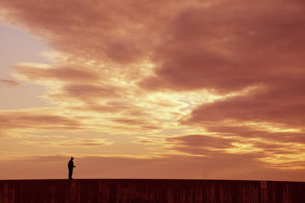 Photograph - Silhouette Of Beach Walkers At Sunset by Steve Estvanik