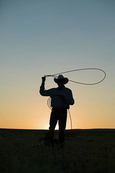 Silhouette Photograph - Silhouette Of Cowboy With Lasso by Edward Mccain