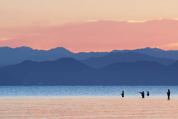 Silhouette Photograph - Silhouette Of Fisherman by Knulp