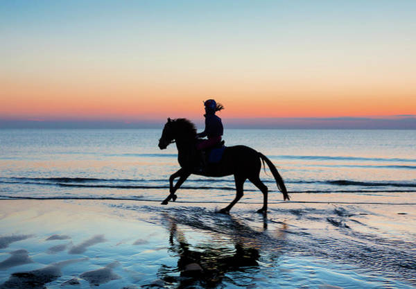 Photograph - Silhouette Of Horse And Rider On Beach At Sunset by Maggie McCall