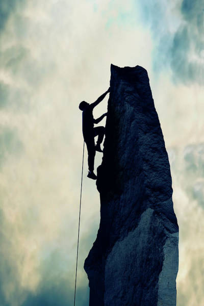 Climbing Photograph - Silhouette Of Man Climbing Rock by Steve Mcalister