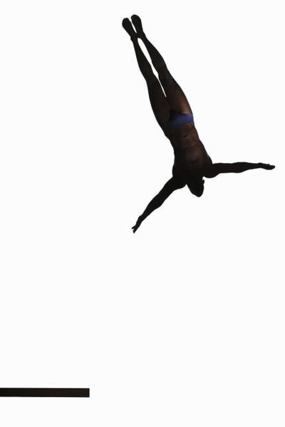 Diving Board Photograph - Silhouette Of Man Jumping Off Diving by Paul Taylor