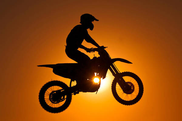 Motorcycle Racing Photograph - Silhouette Of Motocross At Sunset by Shahbaz Hussain's Photos