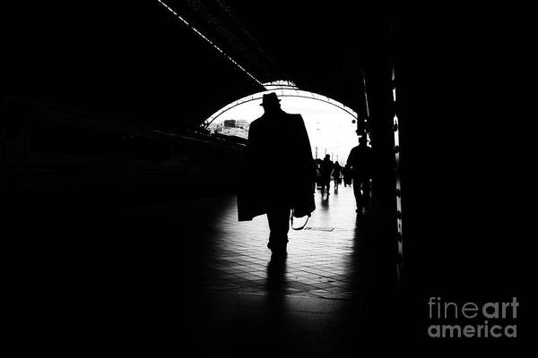 Photograph - Silhouette Of Passengers In A Train Station. by Joaquin Corbalan