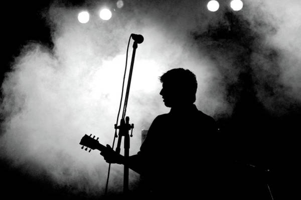 Photograph - Silhouette Of Person Playing Guitar by Hans Neleman