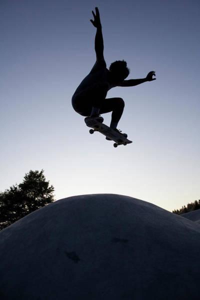 Skateboard Photograph - Silhouette Of Skateboarder Jumping by Darren Pearson (dariustwin)