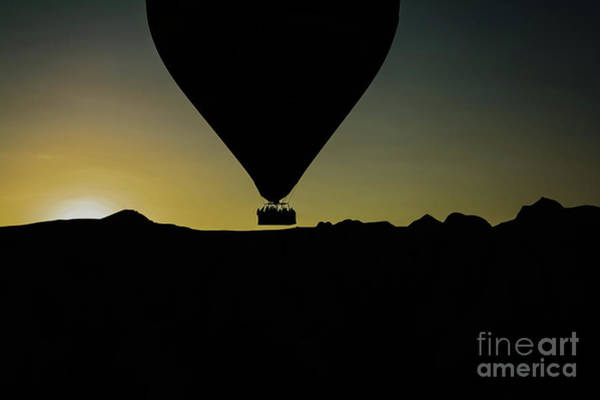 Photograph - Silhouette Of Travelers And Tourists Flying Over Mountains At Su by Joaquin Corbalan