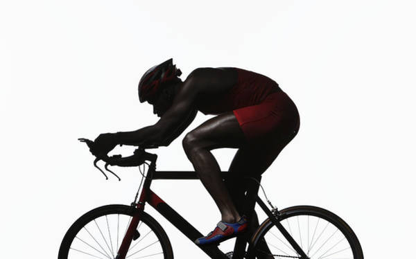 Short Cut Photograph - Silhouette Of Triathlete Riding On by Paul Taylor