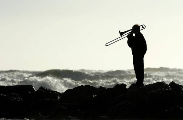 Rock Music Photograph - Silhouette Of Trombonist On Seashore by Foucras G.