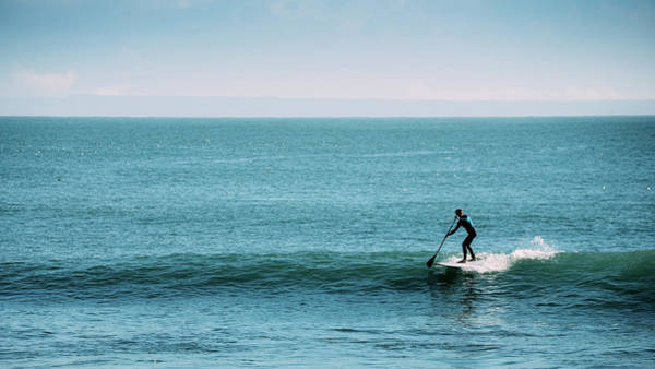 Photograph - Silhouette Of Unidentifiable Man Catching A Wave While On A Stand Up Paddle Board by Alexandre Rotenberg