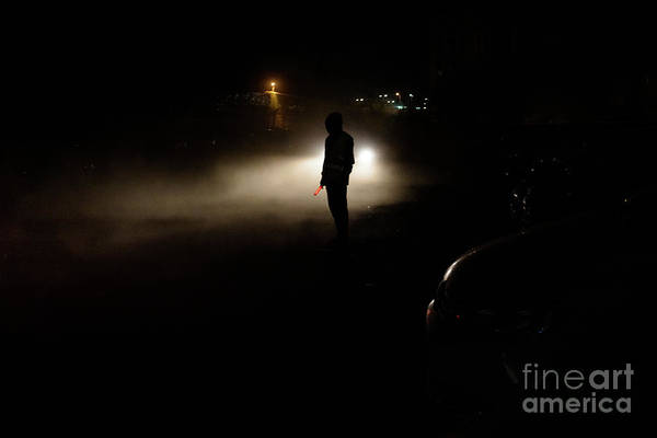 Photograph - Silhouette Of Unrecognizable Man Illuminated By The Headlights Of A Car On A Dark Night. by Joaquin Corbalan