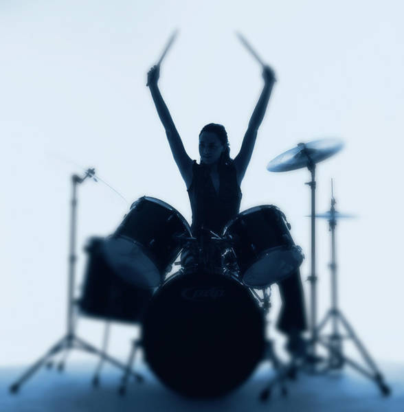 Drum Photograph - Silhouette Of Woman Playing Drums by Pm Images