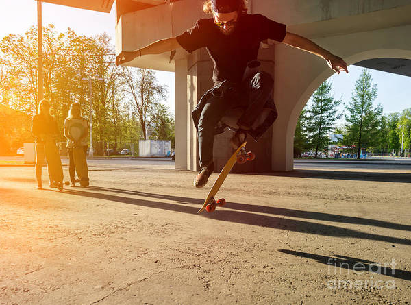 Wall Art - Photograph - Silhouette Skateboarder Jumping In City by Maxim Blinkov