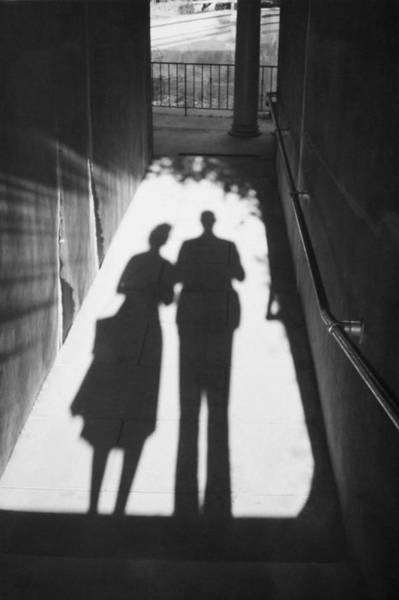 Infidelity Wall Art - Photograph - Silhouetted Couple by Popperfoto