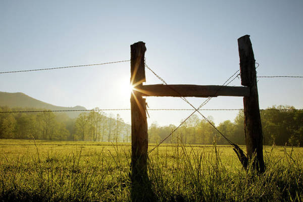 Southern Usa Photograph - Silhouetted Fence Posts At Sunrise by Adam Jones