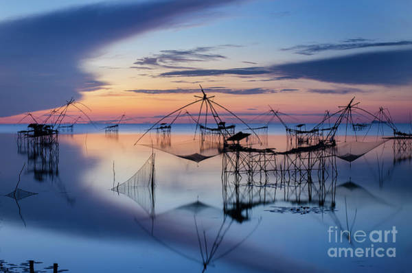 Wall Art - Photograph - Silhouetted Fishing Nets At Sunset In by Nattapon Sritrairat