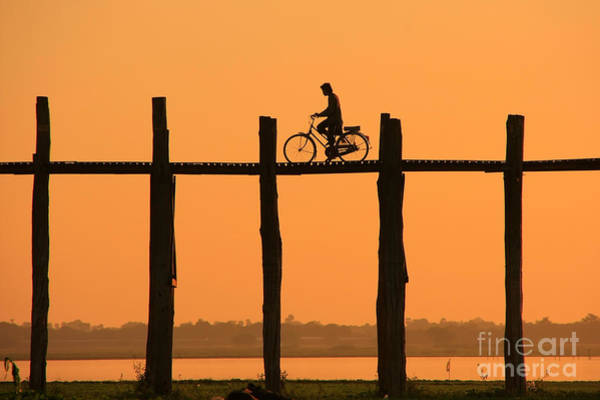 Myanmar Wall Art - Photograph - Silhouetted Person With A Bike On U by Don Mammoser
