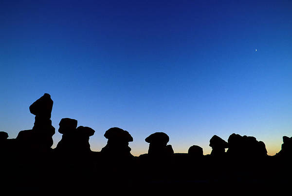 Goblin Valley State Park Photograph - Silhouetted Rock Formations At Dusk by Russ Bishop