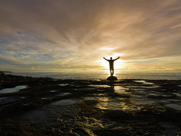 Human Arm Photograph - Silhouetted With Arms Raised On Rocky by Mtnsnail