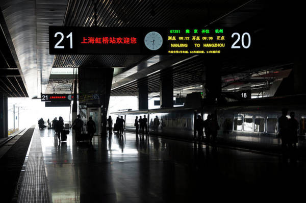 Chinese Language Photograph - Silhouettes Of People In A Train Station by Celine Ramoni Lee