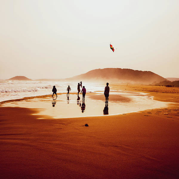 Photograph - People Silhouettes On The Beach 6 by Iordanis Pallikaras