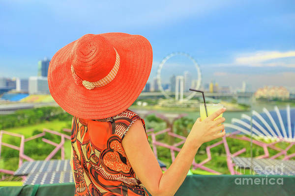 Photograph - Singapore Woman With Orange Juice by Benny Marty