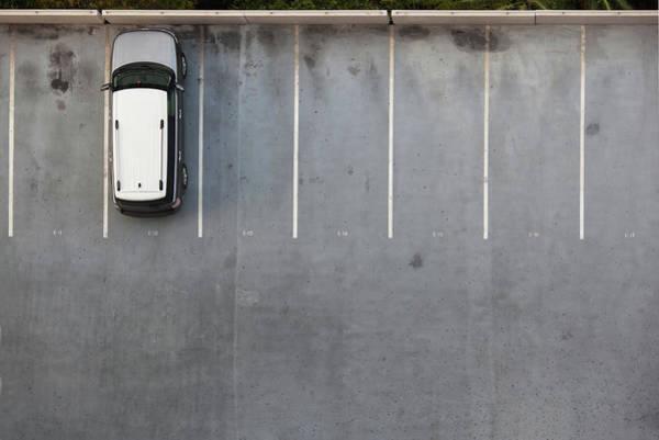 Parking Lot Photograph - Single Car On A Parking Lot by Slobo