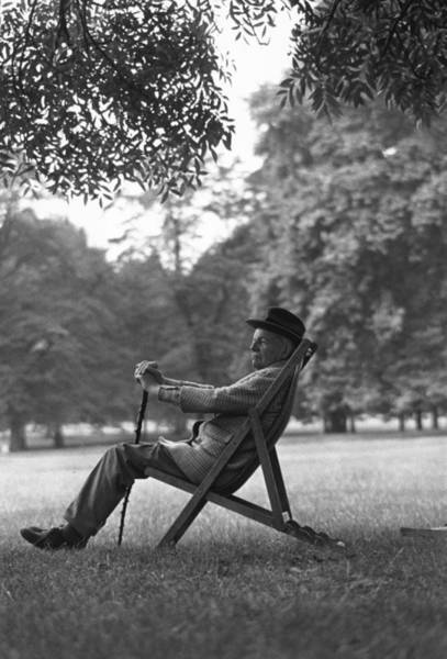 Walking Photograph - Sitting In The Park by Rod Pelham