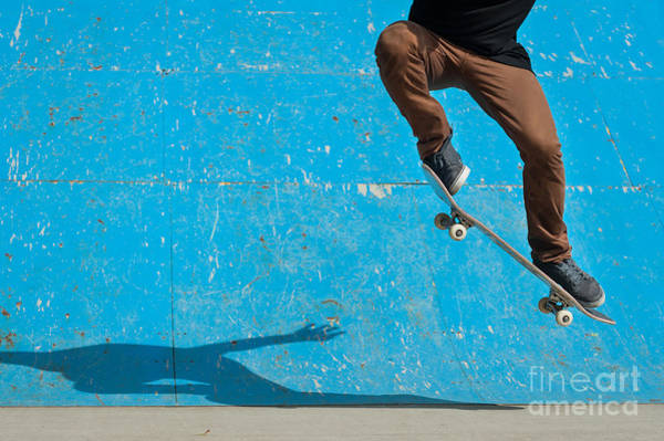 Wall Art - Photograph - Skateboarder Doing A Skateboard Trick - by Pio3