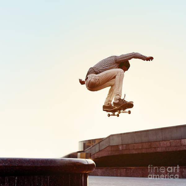 Headband Photograph - Skateboarder Performs A Trick In The by Maksim Shirkov