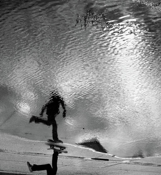 Skateboard Photograph - Skateboarder Reflection In Puddle by Mgs