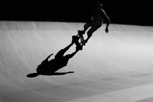 Skateboard Photograph - Skateboarder Riding Ramp At Skate Park by David Madison