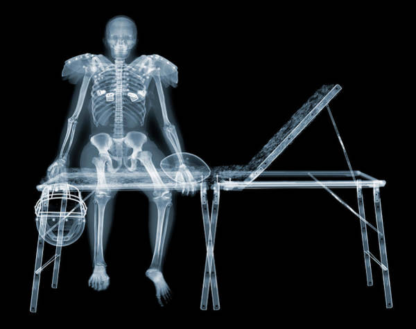 Photograph - Skeleton Of American Footballer Sitting by Nick Veasey