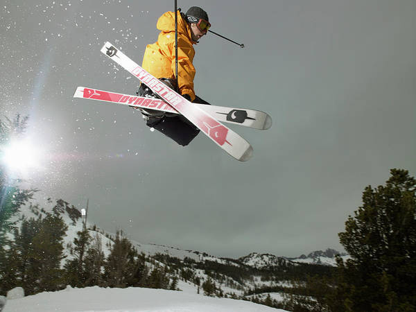 Ski Jumping Photograph - Skier Doing Freestyle Jump In Air by Mike Powell