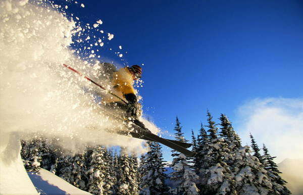 Ski Jumping Photograph - Skier In Mid-air, Creating Snow Spray by Mike Powell