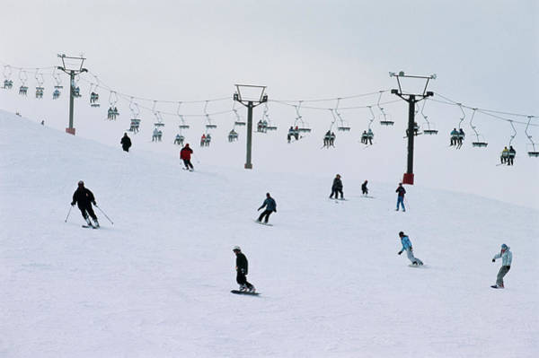 Photograph - Skiers And Snowboarders by John W Banagan