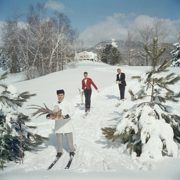 Adult Photograph - Skiing Waiters by Slim Aarons