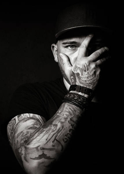 Upper Body Photograph - Skull Tattoo On Hand Covering Face by Johan Swanepoel